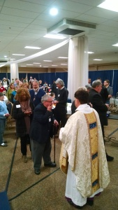 Bishop serving communion